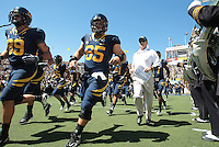 Jeff Tedford runs out onto the field with the players. The University of California Berkeley Golden Bears defeated the UC Davis Aggies 52-3 in their home opener at Memorial Stadium in Berkeley, California on September 4th, 2010.