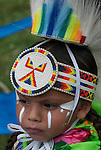 Native American , Chaske Hill Sicangu Lakota and Seneca ,  3 year dressed in regalia and face paint for pow wow dance contest at the Thunderbird powwow in Queens, NY .