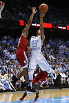 24 February 2015: North Carolina's J.P. Tokoto (13) and NC State's Ralston Turner (left). The University of North Carolina Tar Heels played the North Carolina State University Wolfpack in an NCAA Division I Men's basketball game at the Dean E. Smith Center in Chapel Hill, North Carolina. NC State won the game 58-46.