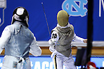 DURHAM, NC - FEBRUARY 25: Duke's Lee Kiefer (right) and Duke's Julia Lee (left) during their Women's Foil semifinal match. The Atlantic Coast Conference Fencing Championships were held on February, 25, 2017, at Cameron Indoor Stadium in Durham, NC.