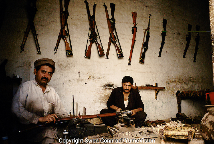 Mens making Butt's for new made rifles. Darra town in Pakistan clandestinely provides arms to more than eight Central Asian countries.