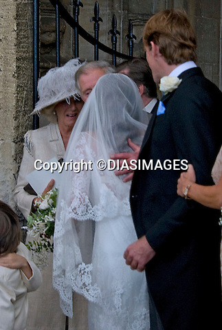 "PRINCE CHARLES KISSES THE BRIDE.BEN ELLIOT AND MARY CLARE WINWOOD WEDDING.Camilla, Duchess of Corwall's nephew Ben Elliot and Mary Clare Winwood daughter of musician Steve Winwood tied the knot at the Church of St Peter & St Paul, Northleach_Gloucestershire_10/09/2011.Mandatory Credit Photo: ©DiasImages/NEWSPIX INTERNATIONAL..**ALL FEES PAYABLE TO: ""NEWSPIX INTERNATIONAL""**..IMMEDIATE CONFIRMATION OF USAGE REQUIRED:.Newspix International, 31 Chinnery Hill, Bishop's Stortford, ENGLAND CM23 3PS.Tel:+441279 324672  ; Fax: +441279656877.Mobile:  07775681153.e-mail: info@newspixinternational.co.uk"