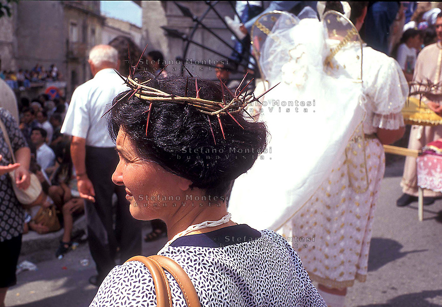Septennial feast of Battenti Guardia Sanframondi Campania Italy.The women wear white clothing, a symbolic crowns of thorns, and braided cords around their shoulders..