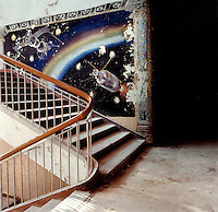 Painted mural of the Soviet spacecraft, the Sputnik, on a staircase in the former piloting school for the Soviet air force.  The Cold War, which formed part of the collective consciousness of post war Europe from 1945 until 1989 dominated the military and political landscape.  Often highly charged with nationalistic zeal, Soviet rhetoric and paranoia, relics of the Cold War remain as testaments to the covert era within Eastern Europe. CHECK with MRM/FNA