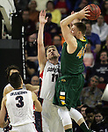 North Dakota State's Dexter Werner (40) go up to pass while being guarded by Gonzaga's Domantas Sabonis (11) during the 2015 NCAA Division I Men's Basketball Championship's March 20, 2015 at the Key Arena in Seattle, Washington.   ©2015. Jim Bryant Photo. ALL RIGHTS RESERVED.