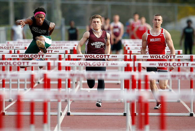 Walcott, CT- 05 May 2015-050515CM05- From left, Wilby's Tyquace Sandelin, Naugatuck's Brian Riley and Wolcott's Nick Wright battle it out during the boys 110m high hurdles   during a track meet at Wolcott on Tuesday afternoon. Sandelin would win the race.   Christopher Massa Republican-American