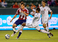 DC United defender Barry Rice attempts a flying tackle of CD Chivas USA forward Justin Braun. CD Chivas USA beat DC United 1-0 at Home Depot Center stadium in Carson, California on Sunday August 29, 2010.