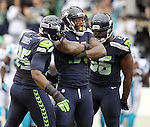 Seattle Seahawks  linebacker Bruce Irvin (51) is con graduated by defensive end DeMarcus Dobbs (95) and defensive end Cliff Avril (56) after sackingCarolina Panthers  quarterback Cam Newton at CenturyLink Field in Seattle on October 18, 2015. The Panthers came from behind with 32 seconds remaining in the 4th Quarter to beat the Seahawks 27-23.  ©2015 Jim Bryant Photography. All Rights Reserved.