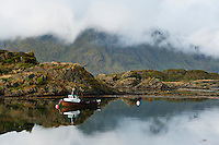 Small fishing boat at mooring, Steine, Lofoten islands, Norway