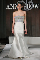 Model walks runway in a Rockefeller wedding dress by Anne Bowen, for the Anne Bowen Bridal Spring 2012 runway show.