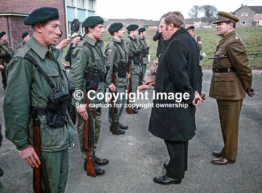 Roy Hattersley, MP, Labour Party, Defence Minister, inspects the first member of the newly-formed Ulster Defence Regiment, UDR, about to go on duty on 1st April 1970 when the regiment became operational for the first time. 197004010112b.<br />