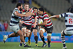 Fritz Lee looks to fend off Charlie Faumuina as he brings the ball forward. ITM Cup Round 7 rugby game between Auckland and Counties Manukau, played at Eden Park, Auckland on Thursday August 11th..Auckland won 25 - 22.