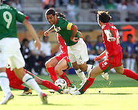 Rafa Marquez of Mexico gets caught in the Iranian defense. Mexico defeated Iran 3-1 during a World Cup Group D match at Franken-Stadion, Nuremberg, Germany on Sunday June 11, 2006.