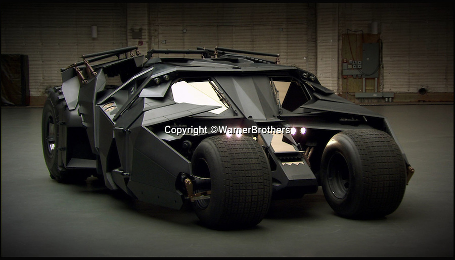 BNPS.co.uk (01202 558833)<br /> Pic: WarnerBrothers/BNPS<br /> <br /> ***Please Use Full Byline***<br /> <br /> The Batmobile that features in the most recent Batman film, The Dark Knight Rises (20/07/12).<br /> <br /> The world's first Batmobile has emerged for sale for a whopping &pound;300,000 after being rescued from a field where it spent almost 50 years languishing.<br /> <br /> Batman's famous car was built more than 50 years ago from a 1956 Oldsmobile 88 that was converted to look just like the one from the comic books which made the Caped Crusader famous.<br /> <br /> It is a far cry from the Batmobile that appeared in Christopher Nolan's modern remakes of Batman.<br /> <br /> But as the first Batmobile ever built, experts at Dallas-based Heritage Auctions say it could sell for as much as $500,000 - more than &pound;300,000.