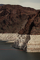 CREDIT: Daryl Peveto / LUCEO for The Wall Street Journal.Photo Assignment ID: 11416 Slug: LAKEMEAD ..Lake Mead, Nevada, March 16, 2011 - A view of the former water line of Lake Mead seen from the Hoover Damn...Lake Mead is the largest water reservoir in the United States. Located on the Colorado River southeast of Las Vegas, it is the major reserve for Nevada, California and Arizona. The city of Las Vegas alone gets 90% of its water from Lake Mead. The lake is currently experiencing a ten year drought, recently dropping to1,083 feet - its lowest level since it was dammed in the 1930s. If it drops further, there is the potential for cutoffs of water for hydro-electricity, agriculture and cities across the Southwest. The current level is near emergency level: if drops to 1075, the Secretary of Interior will have to declare a severe water emergency and major cutbacks will ensue. If gets below 1025, all water for hydro from Hoover Dam shut off. If it falls below 1,000 feet the intake valves that pull water from the Lake for consumption will no longer be operational.