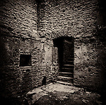 Doorway and steps in medieval castle ruins. Beupre Castle, Wales