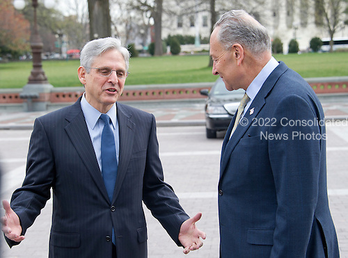 United States Senator Chuck Schumer (Democrat of New York), right, leads Judge Merrick Garland, chief justice for the US Court of Appeals for the District of Columbia Circuit, who is US President Barack Obama's selection to replace the late Associate Justice Antonin Scalia on the US Supreme Court, left, at a photo op at the US Capitol in Washington, DC on Tuesday, March 22, 2016.   <br /> Credit: Ron Sachs / CNP<br /> (RESTRICTION: NO New York or New Jersey Newspapers or newspapers within a 75 mile radius of New York City)