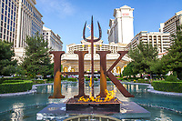 LAS VEGAS, NV - April 28, 2017: ***HOUSE COVERAGE*** The Hell's Kitchen Series iconic pitchfork signage illuminated in flames at the Caesars Place fountains pictured as  Chef Gordon Ramsay announces the world's first Hell's Kitchen Restaurant at Caesars Palace in Las vegas, NV on April 28, 2017. Credit: Erik Kabik Photography/ MediaPunch