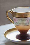 A Haviland cup and saucer sit on a table.