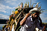 """A man attends the traditional """"Silletero"""" parade during the Flower Festival in Medellin August 7, 2012. Photo by Eduardo Munoz Alvarez / VIEW."""