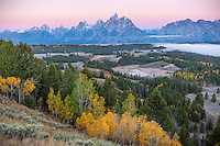 Grand Teton National Park, WY: Dawn light on the Teton Range with fog in the Snake River Valley