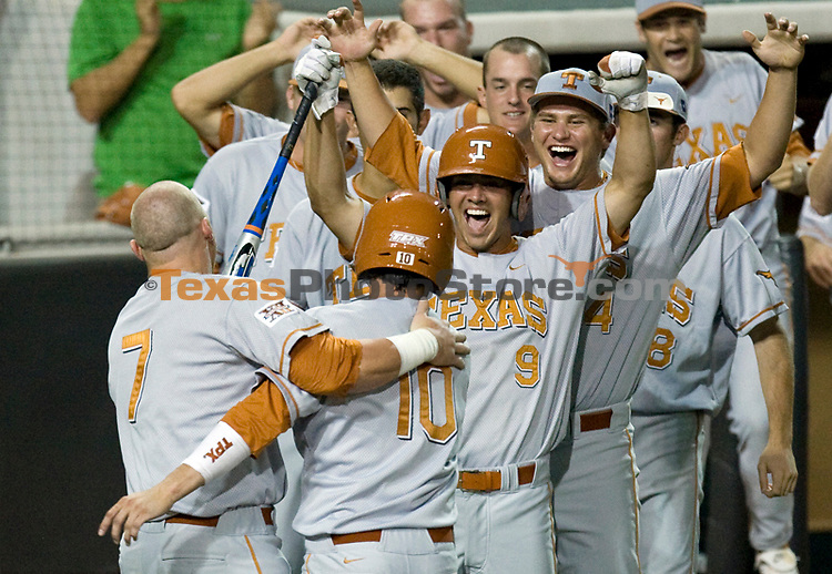 University of Texas first baseman Preston Clark, left, celebrates with Connor Rowe, Michael Torres and Cole Green after Rowe scored the winning run Sunday, May 31, 2009, in the 25th inning of the Longhorn's NCAA Regional matchup against Boston College in Austin, Texas. The 25-inning, seven hour, game now holds the record for the longest in NCAA history.(AP Photo/Matt Hempel University of Texas Sports Information).