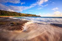 Ocean water rushes off the reef at Moloa'a Bay, Northeast Kaua'i.