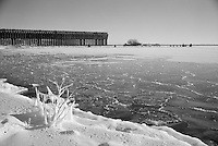 (Film) A winter morning view of Lower Harbor Ore Dock and cold, detailed ice of Lake Superior. Marquette, MI - Ilford Delta Pro 100