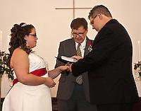 Lydia Delourmel & Mark Fuller exchange wedding vows at the Hookstown Free Methodist Church in Hookstown, Pennsylvania on October 1, 2011. Pastor Wilmer J. Olszewski officiating.
