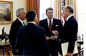 On April 14, 1984, hours before the Libyan maneuvers, United States President Ronald Reagan, right center, holds a White House conference in the Oval Office with John Poindexter, Assistant to the President for National Security Affairs, right, Secretary of Defense Caspar Weinberger, left center, and Chief of Staff Donald Regan, left..Mandatory Credit: Pete Souza - White House via CNP