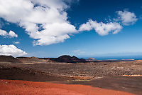 Volcanoes and lava fields, Timanfaya National Park, Lanzarote, Canary Islands, Spain. Six years of continuous volcanic eruptions in the 1700s creatide a magnificent landascape of lava fields, extending to the ocean,  punctuated by volcano slopes.