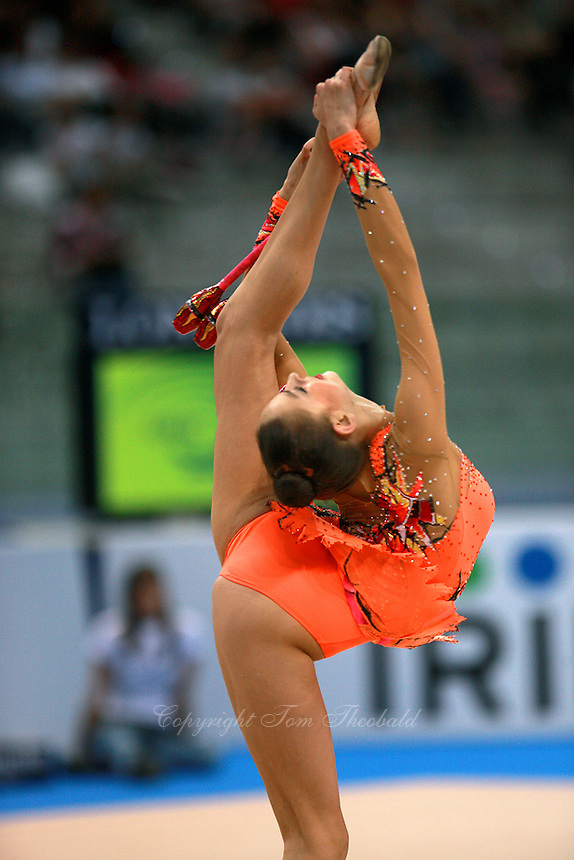 Evgenia Kanaeva of Russia pirouettes with clubs on way to winning All-Around gold at 2008 European Championships at Torino, Italy on June 6, 2008.  Photo by Tom Theobald.