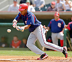 10 March 2006: Brandon Watson, outfielder for the Washington Nationals, lays down a bunt during a Spring Training game against the Houston Astros. The Astros defeated the Nationals 8-6 at Osceola County Stadium, in Kissimmee, Florida...Mandatory Photo Credit: Ed Wolfstein..