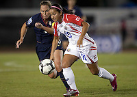 Monica Malavassi of Costa Rica (right) dribbles against Christie Rampone (left). USWNT vs Costa Rica in the 2010 CONCACAF Women's World Cup Qualifying tournament held at Estadio Quintana Roo in Cancun, Mexico on November 8th, 2010.