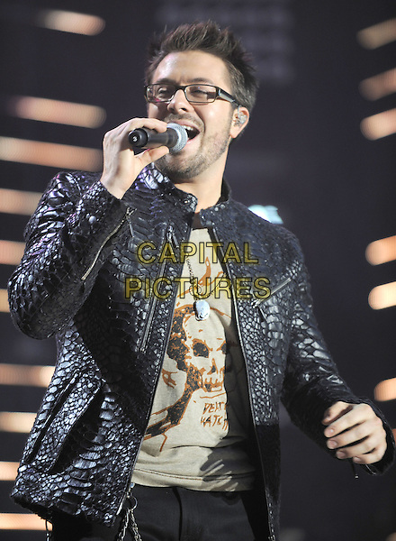 DANNY GOKEY .2010 CMA Music Festival Nightly Concert held at LP Field, Nashville, Tennessee, USA, 10th June 2010..country live on stage concert gig .half length microphone singing glasses black leather jacket croc animal snake snakeskin .CAP/ADM/LF.©Laura Farr/AdMedia/Capital Pictures.