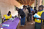 Margaret David Solomon (left), a poll worker in Nzara, in Southern Sudan's Western Equatoria State, registers voters on the first day of a 17-day registration period in preparation for January's referendum on secession from the country's north. Voters are expected to choose overwhelmingly for independence.