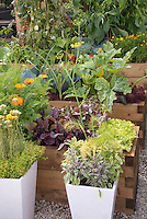 Herbs, vegetables, flowers, pots container garden and raised beds mixed together