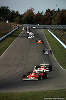 WATKINS GLEN, NY - OCTOBER 5: Niki Lauda #12 Ferrari 312T 023/Ferrari 015 leads Emerson Fittipaldi #1 McLaren M23 8-2/Ford Cosworth, Jean-Pierre Jarier #17 hadow DN5 1A/Ford Cosworth DFV and the rest of the field in the United States Grand Prix on October 5, 1975, at the Watkins Glen Grand Prix Race Course near Watkins Glen, New York.