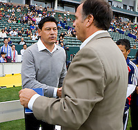 Head coaches of CD Chivas USA Martin Vasquez (l) and Bruce Arena of LA Galaxy (r) shake hands prior to kickoff.  The LA Galaxy beat Chivas USA 2-1 at Home Depot Center stadium in Carson, California on Sunday October 3, 2010.