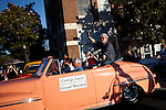 """Filmmaker George Lucas waves to the crowd during the American Graffiti Parade in Modesto, California, June 7, 2013. Modesto is celebrating the 40th anniversary of the film """"American Graffiti"""", with a parade headed up by native son, filmmaker George Lucas."""