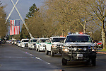 National Park Service vehicles lead the procession during memorial services for National Park Service Ranger Margaret Anderson at the Pacific Lutheran University in Tacoma on January 10, 2010.  Anderson, was slain at Mount Rainier on New Years' Day when she set up a road block to intercept a vehicle, driven by Benjamin Barnes, who failed to stop at a chain-up checkpoint.  Barnes, the suspect  in the shooting was found dead was found dead the next day. He had drown in Paradise Creek. ©2012. Jim Bryant Photo. All RIGHTS RESERVED.