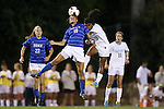 31 October 2013: Duke's Kim DeCesare (left) wins a header against North Carolina's Crystal Dunn (right). The University of North Carolina Tar Heels hosted the Duke University Blue Devils at Fetzer Field in Chapel Hill, NC in a 2013 NCAA Division I Women's Soccer match. North Carolina won the game 3-0.