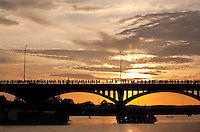 Beautiful sunset during the bat exodus over the Congress Avenue bridge in Austin, Texas