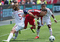 29 June 2013: Toronto FC midfielder Jonathan Osorio #21battles with Real Salt Lake midfielder Kyle Beckerman #5 and Real Salt Lake forward Joao Plata #8 during an MLS game between Real Salt Lake and Toronto FC at BMO Field in Toronto, Ontario Canada.<br /> Real Salt Lake won 1-0.