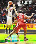 "Mississippi's Marshall Henderson (22) makes a three pointer over Rutgers' Myles Mack (4) and Rutgers' Austin Johnson (21) at the C.M. ""Tad"" Smith Coliseum in Oxford, Miss. on Saturday, December 1, 2012. Mississippi won 80-67. (AP Photo/Oxford Eagle, Bruce Newman).."