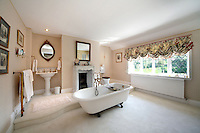 BNPS.co.uk (01202 558833).Pic: Savills/BNPS..***Please use full byline***..Lavish bathroom....This quintessentially English property a short Aston Martin drive from the centre of London is leaving potential buyers shaken and stirred...Its the former home of James Bond star Roger Moore, where he lived when he shot his first three 007 movies in the 1970's.. .Sherwood House lies 20 miles west of central London in the village of Denham, Bucks.. .Moore's former home includes five bedrooms, a drawing room, study, library, gym, conservatory and of course a snooker room, wine cellar and swimming pool.. .The 11-acre property also has an annexe and guesthouse.. .Moore was the longest serving James Bond actor, spending 12 years in the role and featuring in seven Bond films from 1973 to 1985...Any potential buyers wanting to live the life of one of Her Majestys Secret Agents will have to find £4.5 million for the property.