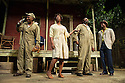 London, UK. 21.06.2013. FENCES, by August Wilson, opens at the Duchess Theatre, in London's West End, following a successful run at Theatre Royal Bath. Lenny Henry takes on the lead role of Troy Maxson in, this production, which is directed by Paulette Randall. Picture shows: Colin McFarlane (Jim Bono), Tanya Moodie (Rose), Lenny Henry (Troy Maxson) and Peter Bankole (Lyons). Photograph © Jane Hobson.