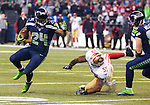 Seattle Seahawks running back Marshawn Lynch (24) rushes against the San Francisco 49ers linebacker Ahmad Brooks (55) during the NFL  Championship Game at CenturyLink Field in Seattle, Washington on January 19, 2014.  Lynch rushed for 109 yards and scored one touchdown in the Seahawks 23-17 win over the 49ers. The Seahawks will represent the NFC in the Super Bowl. ©2014. Jim Bryant Photo. ALL RIGHTS RESERVED.