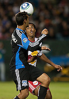 Chris Wondolowski heads the ball over Roy Miller. The New York Red Bulls defeated the San Jose Earthquakes 1-0 at Buck Shaw Stadium in Santa Clara, California on October 30th, 2010.
