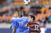 Houston, TX -  Friday, December 9, 2016: Jelani Pieters (26) of the North Carolina Tar Heels attempts to gain control of a loose ball in the second half  at the  NCAA Men's Soccer Semifinals at BBVA Compass Stadium.